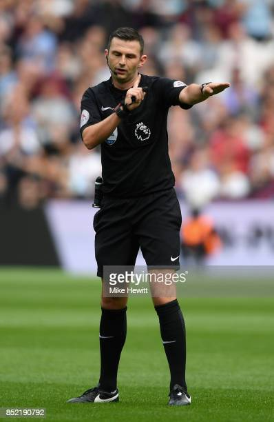 Referee Michael Oliver gesutres during the Premier League match between West Ham United and Tottenham Hotspur at London Stadium on September 23 2017...