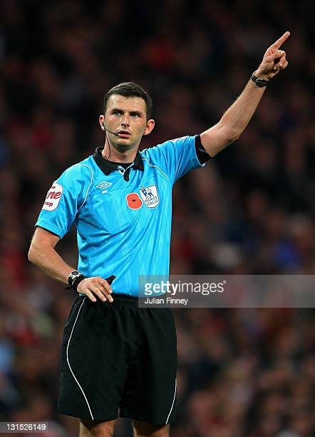 Referee Michael Oliver gives a decision during the Barclays Premier League match between Arsenal and West Bromwich Albion at Emirates Stadium on...