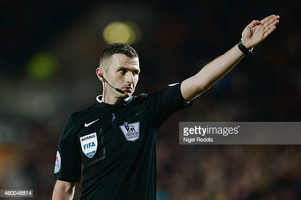Referee Michael Oliver gives a decision during the Barclays Premier League match between Hull City and West Bromwich Albion at the KC Stadium on...