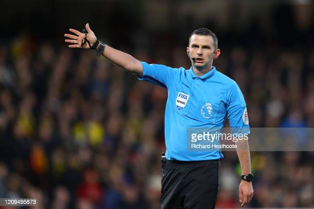 Referee Michael Oliver gives instructions during the Premier League match between Watford FC and Liverpool FC at Vicarage Road on February 29, 2020...