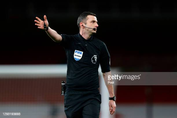 Referee Michael Oliver gives instructions during the Premier League match between Arsenal and Chelsea at Emirates Stadium on December 26, 2020 in...