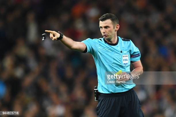 Referee Michael Oliver gives instructions during the UEFA Champions League Quarter Final Second Leg match between Real Madrid and Juventus at Estadio...