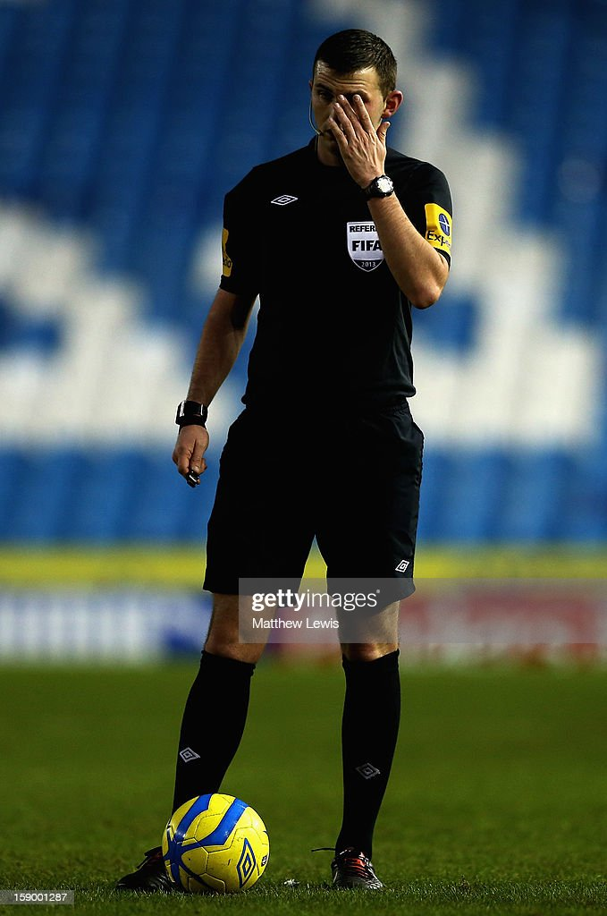Referee Michael Oliver in action during the FA Cup with Budweiser Third Round match between Sheffield Wednesday and Milton Keynes Dons at Hillsborough Stadium on January 5, 2013 in Sheffield, England.