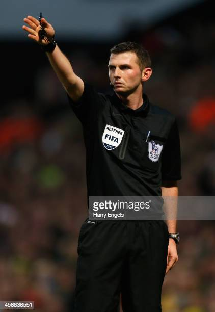 Referee Michael Oliver in action during the Premier League match between Norwich City and Swansea City at Carrow Road on December 15 2013 in Norwich...
