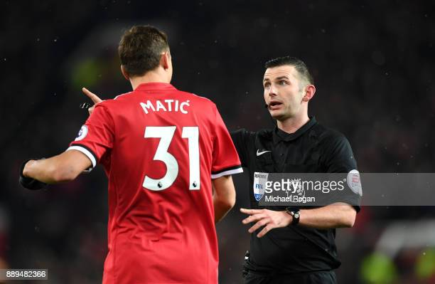 Referee Michael Oliver in discussion with Nemanja Matic of Manchester United during the Premier League match between Manchester United and Manchester...