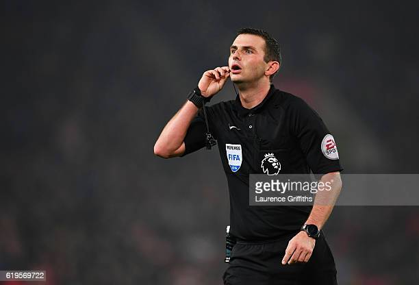 Referee Michael Oliver looks on during the Premier League match between Stoke City and Swansea City at Bet365 Stadium on October 31 2016 in Stoke on...