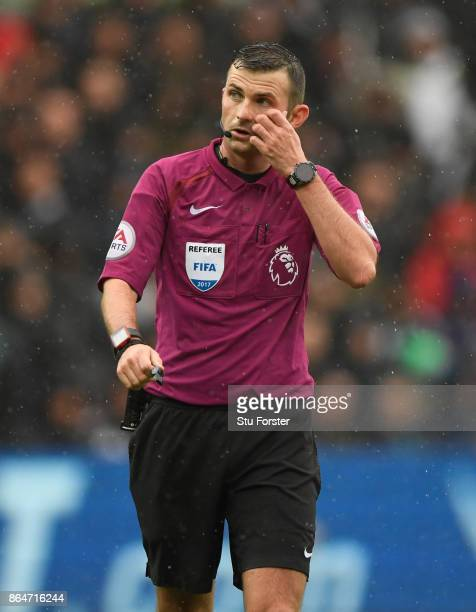 Referee Michael Oliver looks on during the Premier League match between Swansea City and Leicester City at Liberty Stadium on October 21 2017 in...