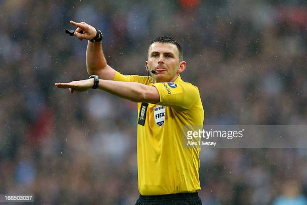 Referee Michael Oliver makes a decision during the FA Cup with Budweiser Semi Final match between Millwall and Wigan Athletic at Wembley Stadium on...