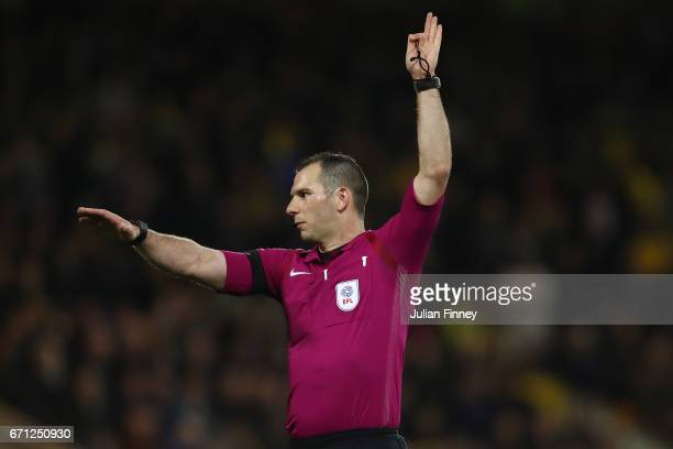 Referee Michael Oliver makes a decision during the Sky Bet Championship match between Norwich City and Brighton Hove Albion at Carrow Road on April...
