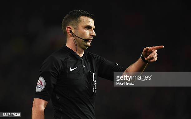 Referee Michael Oliver points during the Premier League match between Manchester United and Liverpool at Old Trafford on January 15 2017 in...