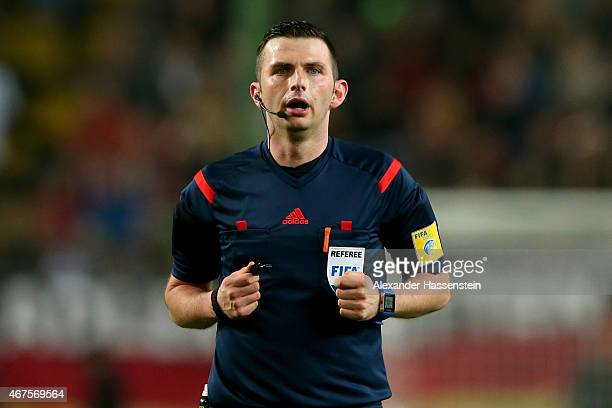 Referee Michael Oliver reacts during the International Friendly match between Germany and Australia at FritzWalterStadion on March 25 2015 in...