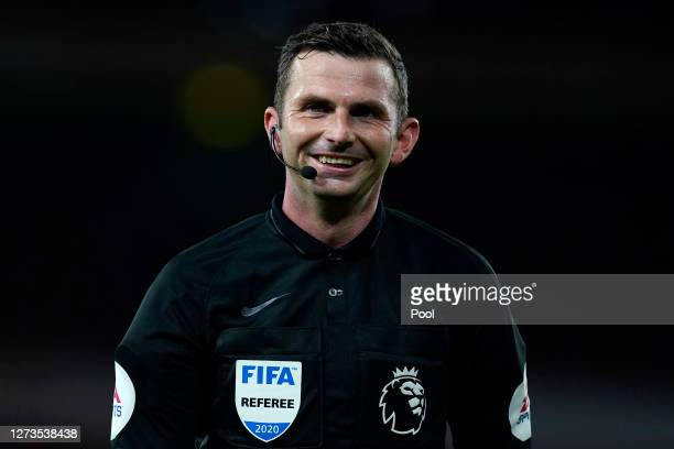 Referee Michael Oliver reacts during the Premier League match between Arsenal and West Ham United at Emirates Stadium on September 19, 2020 in...