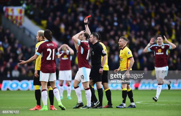Referee Michael Oliver shows a red card to Jeff Hendrick of Burnley during the Premier League match between Watford and Burnley at Vicarage Road on...