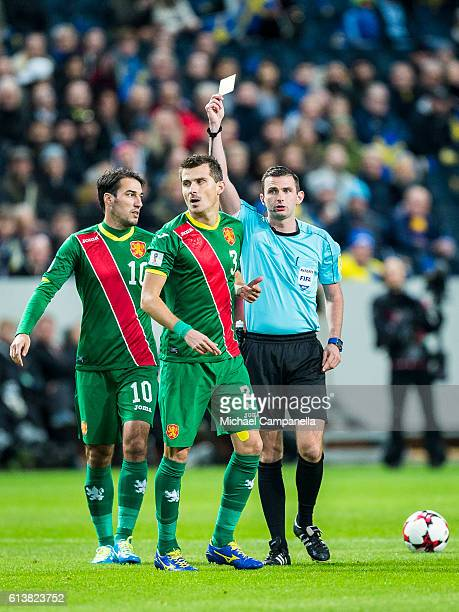 Referee Michael Oliver shows a yellow card to Aleksandar Aleksandrov of Bulgria during the 2018 FIFA World Cup Qualifier match between Sweden and...