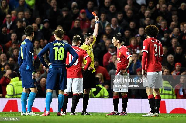Referee Michael Oliver shows the red card to Angel di Maria of Manchester United after he tugged at the referees shirt following a yellow card during...