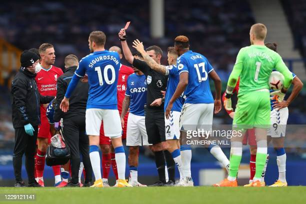 Referee Michael Oliver shows the red card to Everton's Brazilian striker Richarlisonduring the English Premier League football match between Everton...