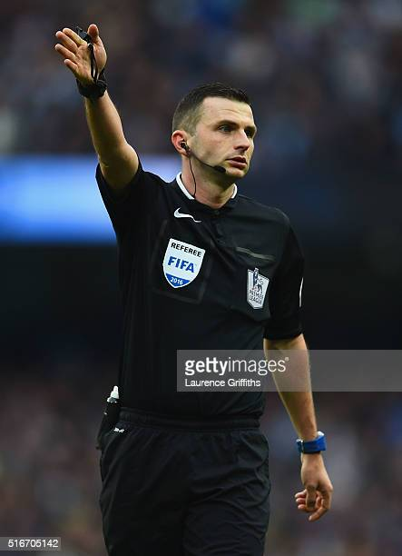 Referee Michael Oliver signals during the Barclays Premier League match between Manchester City and Manchester United at Etihad Stadium on March 20...
