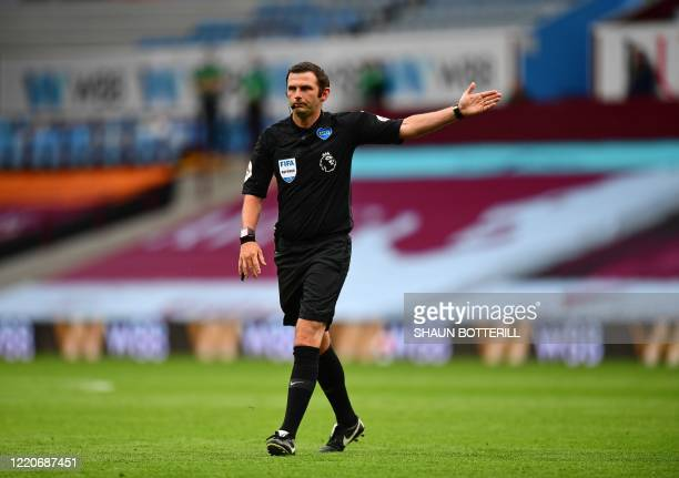 Referee Michael Oliver signals during the English Premier League football match between Aston Villa and Sheffield United at Villa Park in Birmingham,...