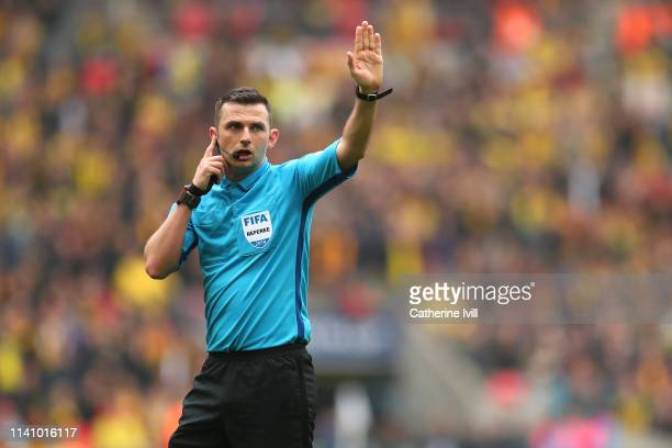Referee Michael Oliver signals during the FA Cup Semi Final match between Watford and Wolverhampton Wanderers at Wembley Stadium on April 07, 2019 in...