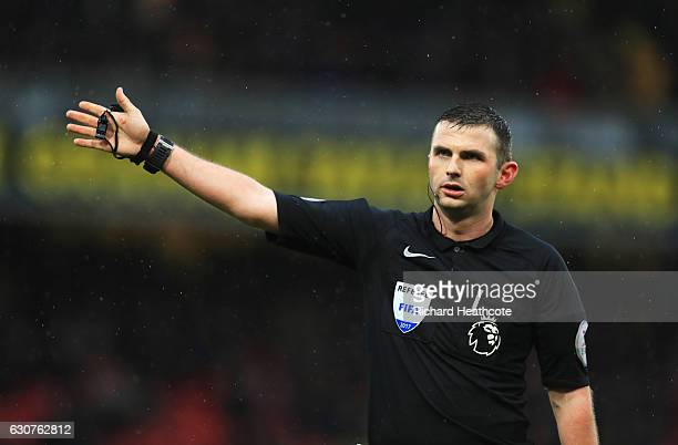 Referee Michael Oliver signals during the Premier League match between Watford and Tottenham Hotspur at Vicarage Road on January 1 2017 in Watford...