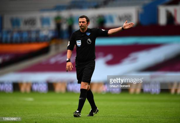 Referee Michael Oliver signals during the Premier League match between Aston Villa and Sheffield United at Villa Park on June 17, 2020 in Birmingham,...