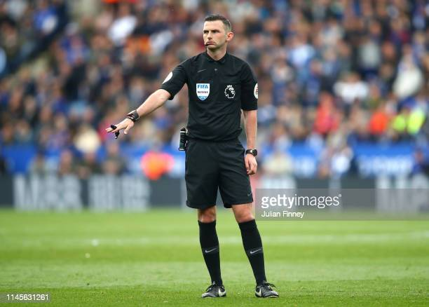 Referee Michael Oliver signals during the Premier League match between Leicester City and Arsenal FC at The King Power Stadium on April 28 2019 in...