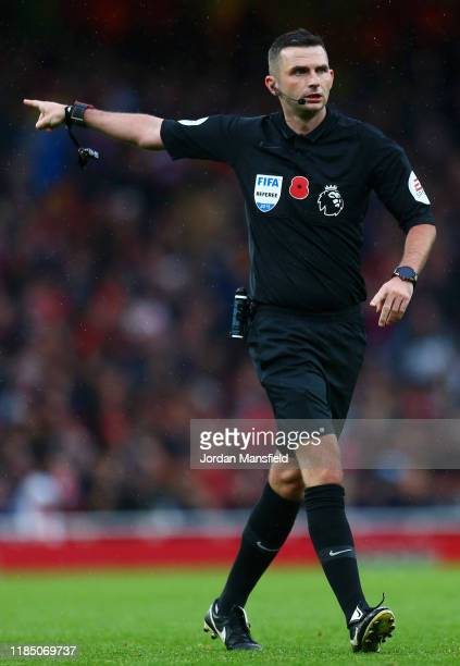 Referee Michael Oliver signals during the Premier League match between Arsenal FC and Wolverhampton Wanderers at Emirates Stadium on November 02,...