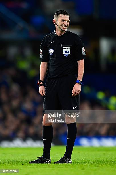 Referee Michael Oliver smiles during the Capital One Cup SemiFinal second leg between Chelsea and Liverpool at Stamford Bridge on January 27 2015 in...