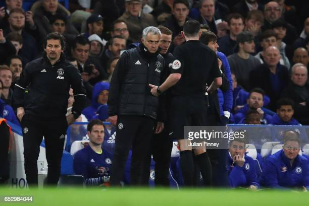 Referee Michael Oliver speaks to Jose Mourinho manager of Manchester United and Antonio Conte manager of Chelsea as they clash during The Emirates FA...