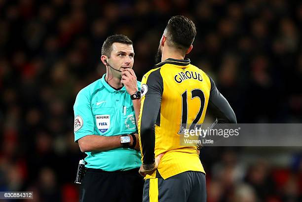 Referee Michael Oliver talks to Olivier Giroud of Arsenal during the Premier League match between AFC Bournemouth and Arsenal at Vitality Stadium on...