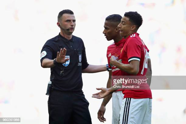 Referee Michael Oliver talks with Antonio Valencia and Jesse Lingard both of Manchester United during the Emirates FA Cup Final between Chelsea and...