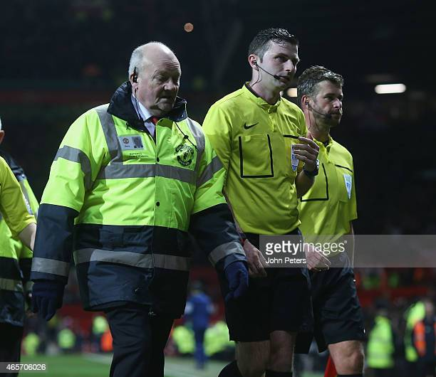 Referee Michael Oliver walks off after the FA Cup Quarter Final match between Manchester United and Arsenal at Old Trafford on March 9 2015 in...
