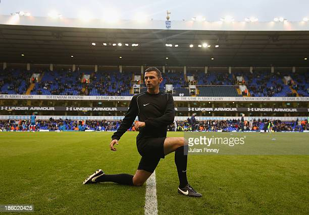 Referee Michael Oliver warms up ahead of during the Barclays Premier League match between Tottenham Hotspur and Hull City at White Hart Lane on...