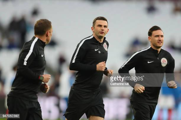 Referee Michael Oliver warms up prior to the Premier League match between West Ham United and Stoke City at London Stadium on April 16, 2018 in...
