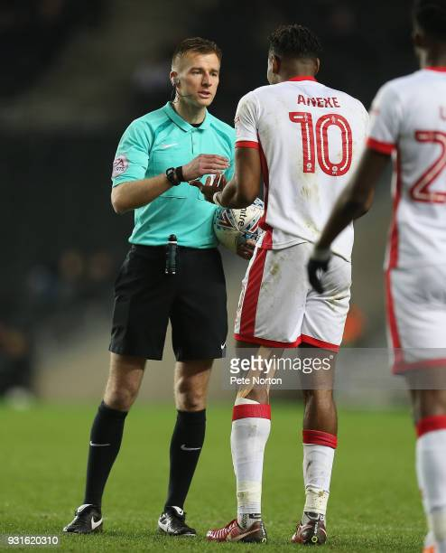 Referee Michael Salisbury makes a point to Chuks Aneke of Milton Keynes Dons during the Sky Bet League One match between Milton Keynes Dons and...