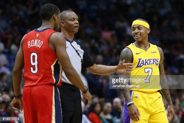 Referee Michael Smith breaks up an altercation between Isaiah Thomas of the Los Angeles Lakers and Rajon Rondo of the New Orleans Pelicans during the...