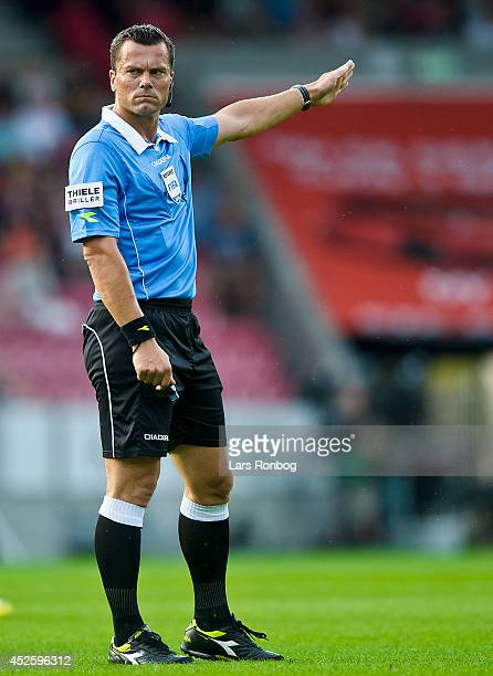 Referee Michael Tykgaard gives instructions during the Danish Superliga match between FC Midtjylland and Brondby IF at MCH Arena on July 20 2014 in...