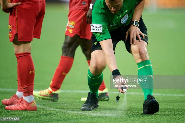 Referee Michael Tykgaard use vanishing spray during the Danish Alka Superliga match between FC Nordsjalland and FC Midtjylland at Right to Dream Park...