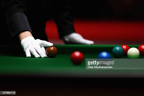 Referee Michaela Tabb places the brown ball on the table in the match between Ronnie O'Sullivan of England and Mark Allen of Northern Ireland in...