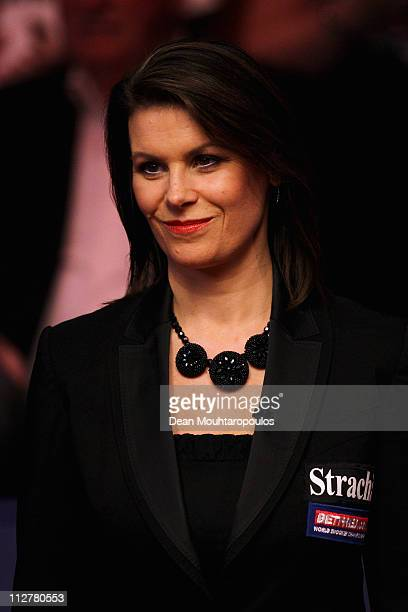 Referee Michaela Tabb watches Judd Trump of England in the round two game against Martin Gould of England on day six of the Betfredcom World Snooker...