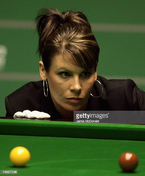 Referee Michaela Tabb watches the balls during the second round match between Joe Swail of Northern Ireland and Stephen Maguire of Scotland in the...