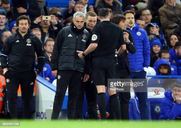 Referee Micheal Oliver having words with Manchester United manager Jose Mourinho and Chelsea manager Antonio Conte during the The Emirates FA Cup...