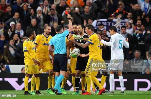 Referee Micheal Oliver sends off Gianluigi Buffon during the UEFA Champions League Quarter Final Second Leg match between Real Madrid and Juventus at...
