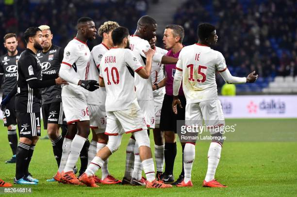 Referee Michel Miguelgorry speaks with Adama Soumaoro of Lille during the Ligue 1 match between Olympique Lyonnais and Lille OSC at Parc Olympique on...