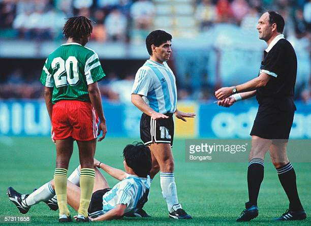 Referee Michel Vautrot of Sweden with Diego Maradona of Argentina during the FIFA World Cup Group B match between Argentina and Cameroon on June 8...
