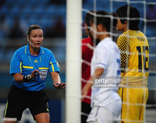 Referee Michelle Pye contols the players during the FIFA U17 Women's World Cup Semi Final match between South Korea and Spain at the Ato Boldon...