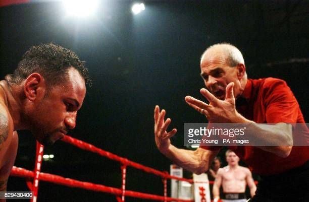 Referee Micky Vann gives a count to Ray Oliveira from USA during the WBU lightwelterweight title bout against Ricky Hatton from Manchester at...