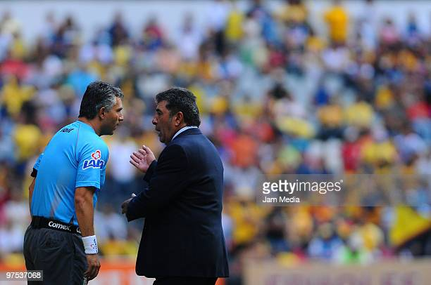 Referee Miguel Angel Flores and Queretaro head coach Carlos Reinoso during the match between Queretaro v America as part of the 2010 Bicentenary...