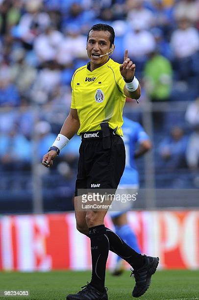 Referee Miguel Angel Flores gestures during a match between Cruz Azul and Queretaro as part of the 2010 Bicentenary Tournamen at the Azul Stadium on...