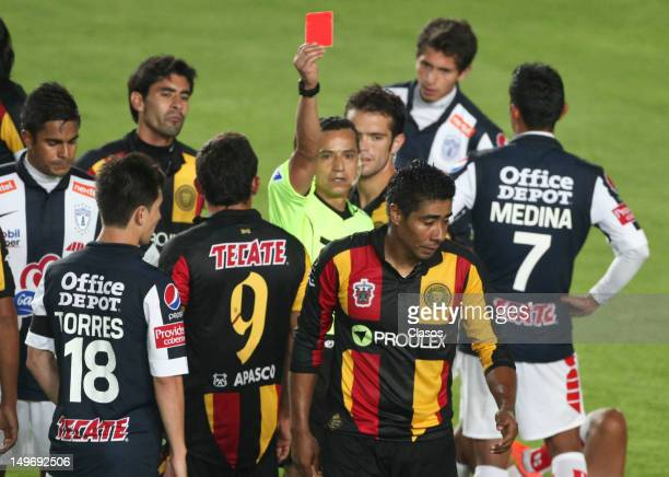 Referee Miguel Angel Flores shows a red card during a match between Pachuca and Leones Negros as part of the Copa MX 2012 at Hidalgo Stadium on...